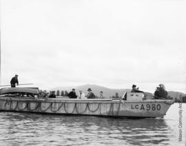 Men and women on the naval barge LCA980