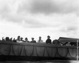 Men and women on a naval barge