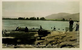 Loading lumber on scows, Mission City, B.C.